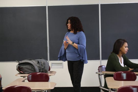 Johnson City High School Spanish teacher Magdala Bedrin teaches her students about Colombian culture during her Spanish class on Oct. 31.