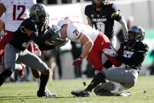 Running back Max Borghi, center, and the Washington State running game don't get much attention in the Cougars' Air Raid attack. But coach Mike Leach says they are critical to the team's success.