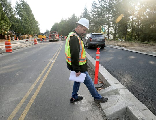 Kitsap County Department of Public Works Ridgetop Boulevard project manager Gunnar Fridriksson at the site of a future roundabout at Quail Run on Tuesday.