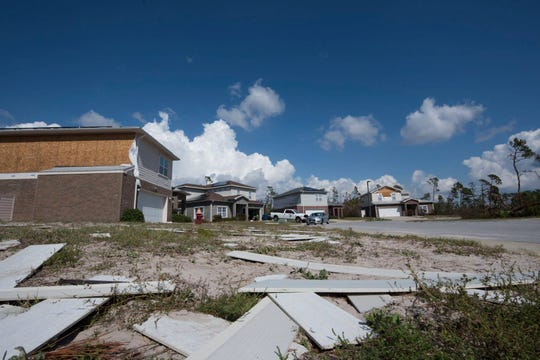 Debris lies in a yard Oct. 19, 2018 at Tyndall Air Force Base, Fla. In the aftermath of Hurricane Michael. Every home on Tyndall AFB was damaged, and residents would be unable to return permanently for the long term.