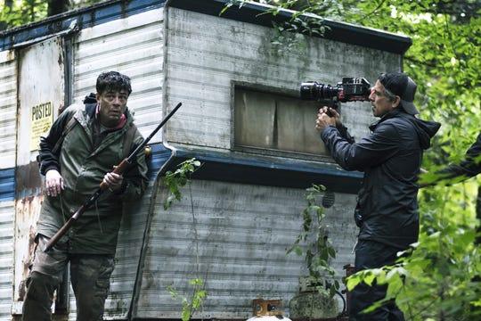 """Producer/director Ben Stiller, right, shoots a scene featuring Benicio Del Toro in """"Escape at Dannemora."""""""