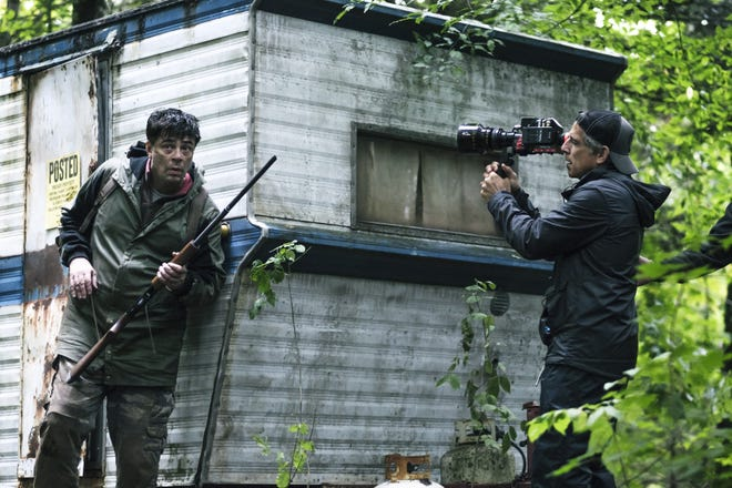 "Producer/director Ben Stiller, right, shoots a scene featuring Benicio Del Toro in ""Escape at Dannemora."""