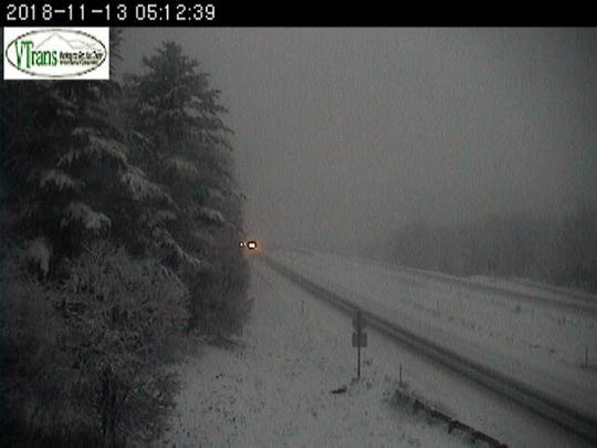 An image taken shortly after 5 a.m. Tuesday, Nov. 13,  2018, by a stationery Vermont Agency of Transportation camera shows the impact of snowfall on Interstate 89 in Berlin.