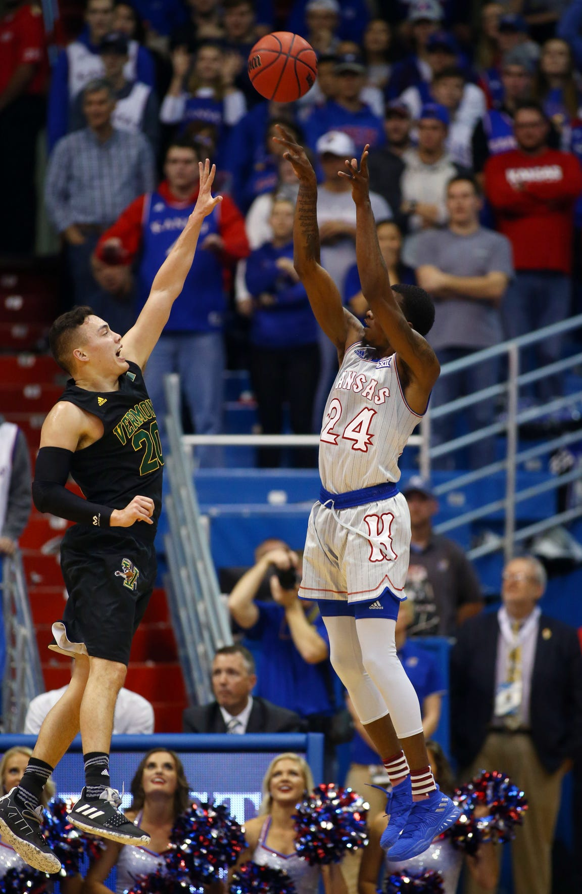 Nov 12, 2018; Lawrence, KS, USA; Kansas Jayhawks guard Lagerald Vick (24) shoots over Vermont Catamounts guard Ernie Duncan (20) in the first half at Allen Fieldhouse.