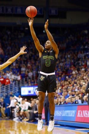 Nov 12, 2018; Lawrence, KS, USA; Vermont Catamounts guard Stef Smith (0) shoots the ball against the Kansas Jayhawks in the first half at Allen Fieldhouse.