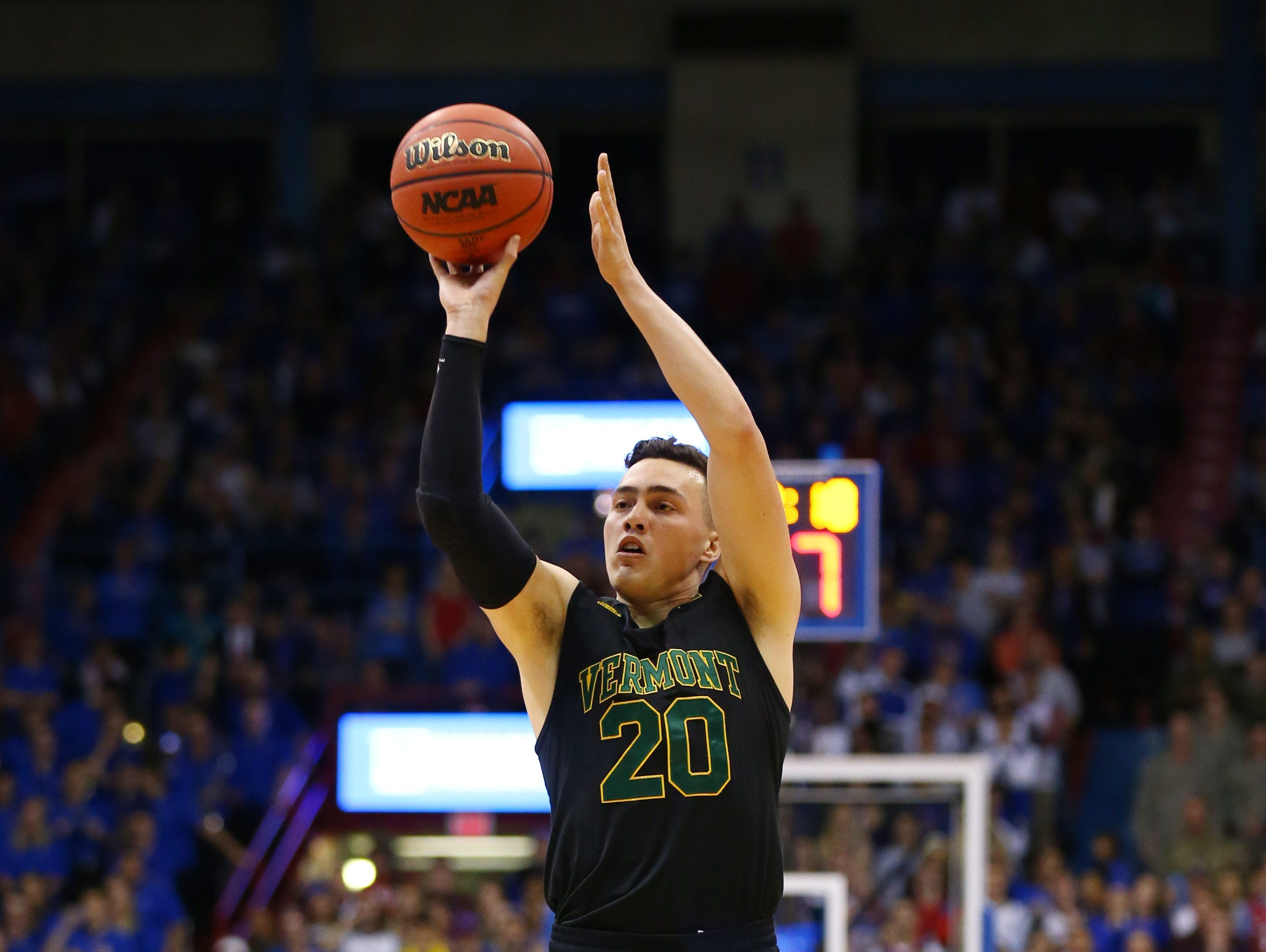 Nov 12, 2018; Lawrence, KS, USA; Vermont Catamounts guard Ernie Duncan (20) shoots against the Kansas Jayhawks in the first half at Allen Fieldhouse.