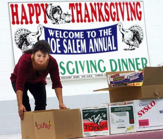 Gloria Martinez, helps set up at the annual Joe Salem Thanksgiving Dinner in 2008.