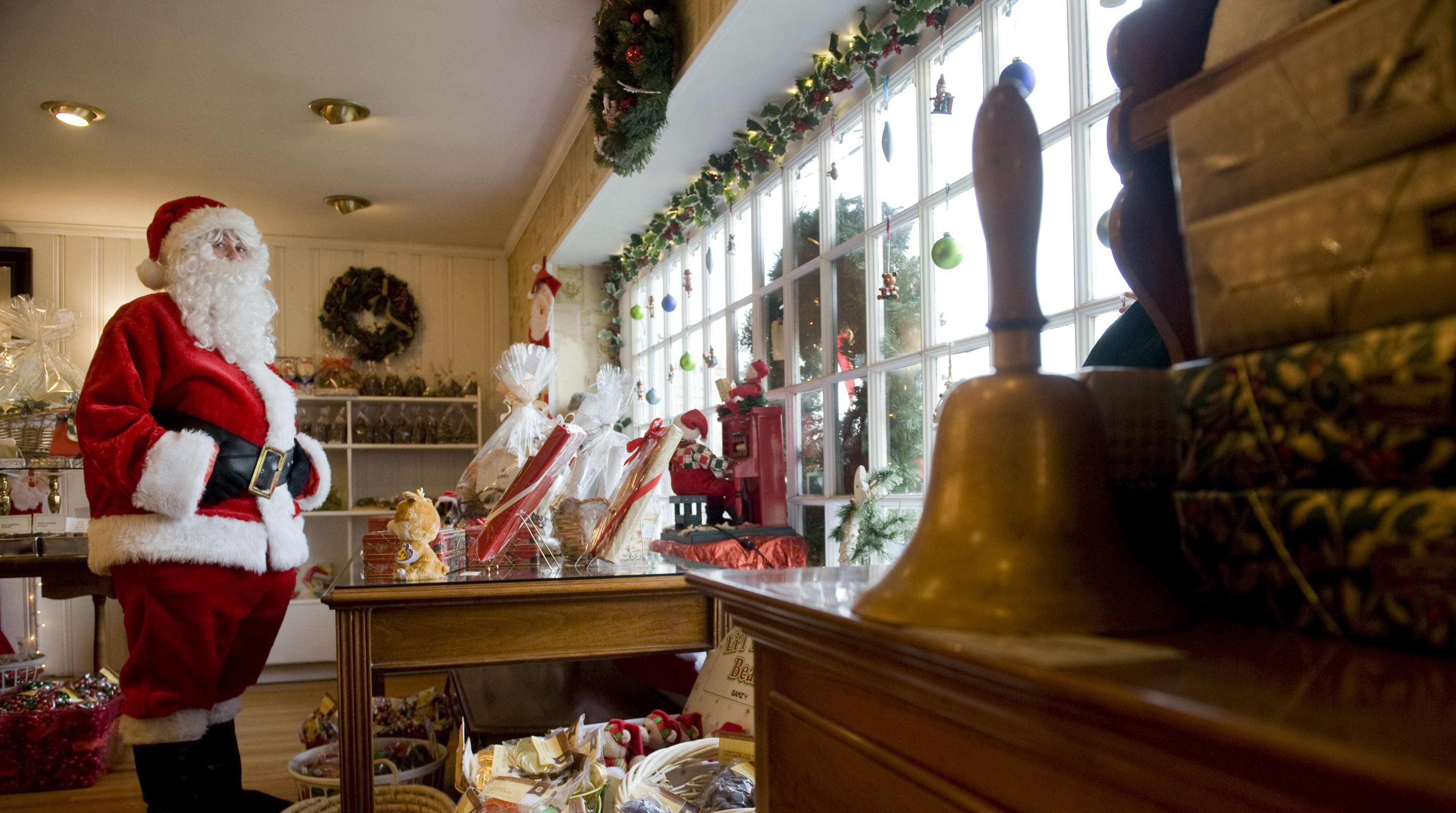 Lauren Weber dresses as Santa to greet passersby from the window of Bayard's Chocolate House in Cherry Hill in 2012.