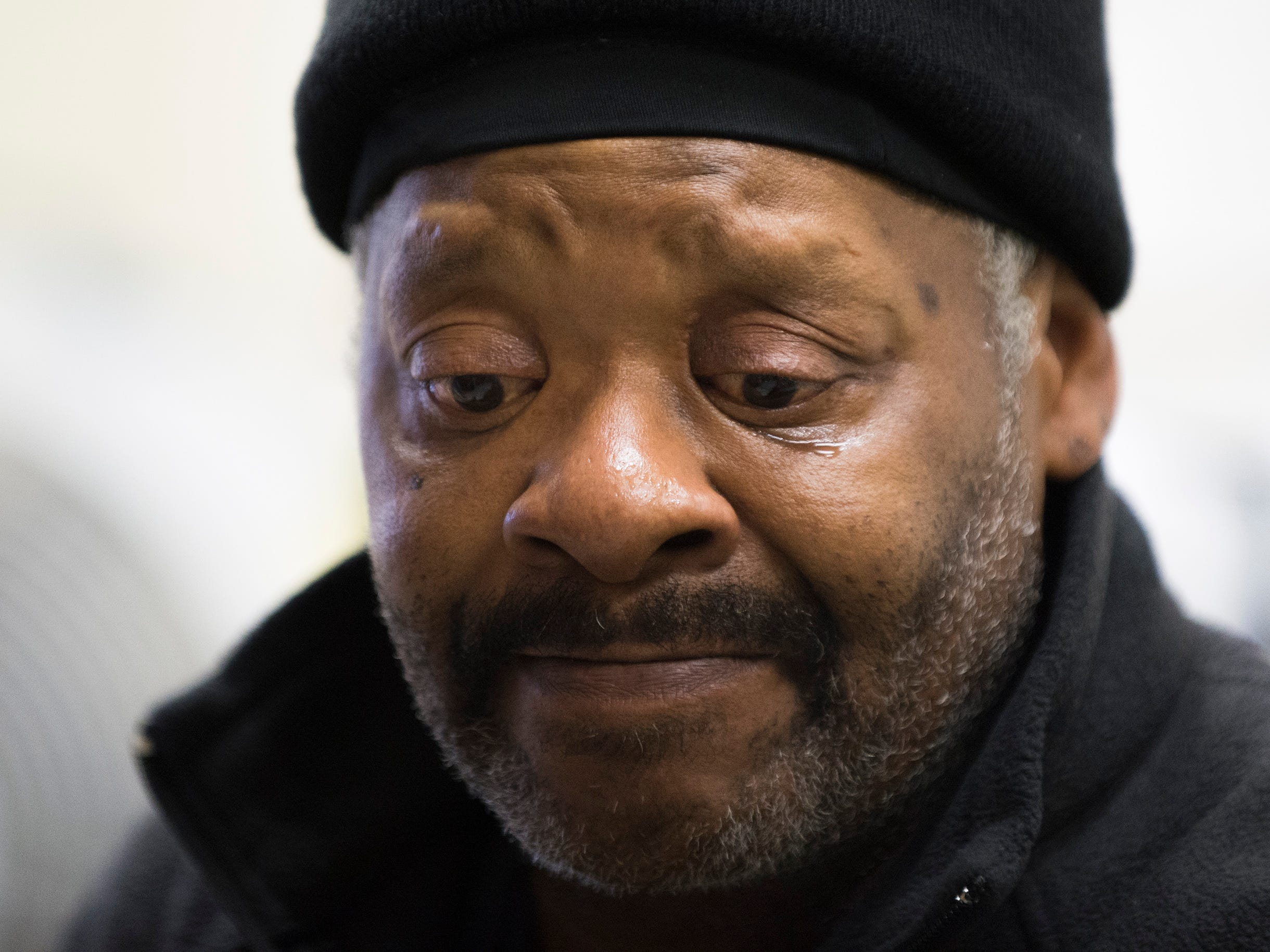 Robert Carroway, 60, who is homeless, reflects on his past circumstances Tuesday, Nov. 13, 2018 at Joseph's House in Camden, N.J. Carroway suffered multiple family tragedies over the years but is now on track to receive proper identification and social security.