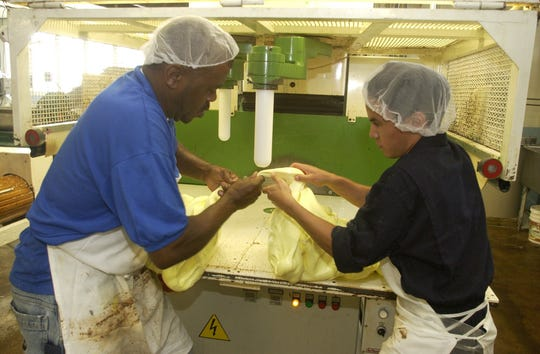 James Candy employees pull taffy before putting it on a chilling table at the company's Atlantic City factory.