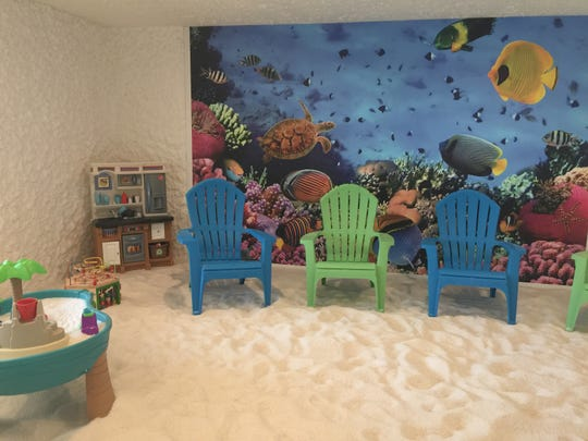 A kids room at The Salt Suite. A franchise is opening in Moorestown in December. The kids room looks like a beach scene with salt covering the floor.