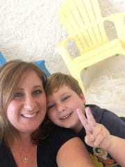 Kristi Hansen, the general manager of The Salt Suite Moorestown location, scheduled to open in December, is shown with her son Zachary at a Salt Suite site. Her son has been a beneficiary of the natural therapy, which she said has helped his asthma and allergies immensely.