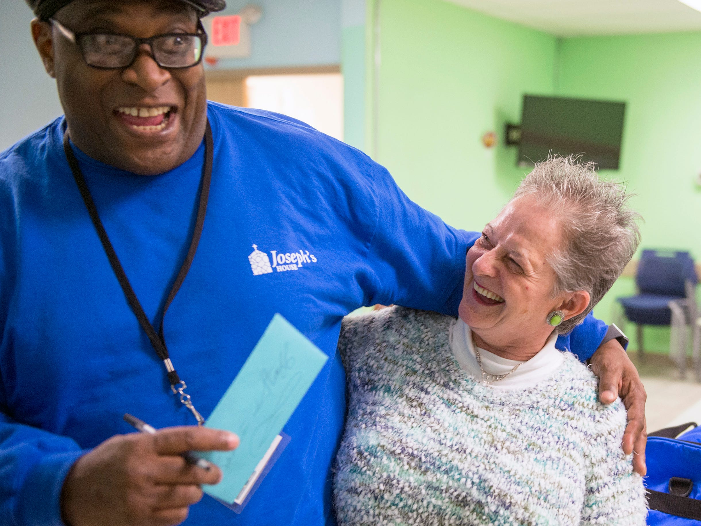 Intake Supervisor Ernest 'Radio' Lindsay, left, is embraced by former guest Diana Stanford, 62, of Gloucester County Tuesday, Nov. 13, 2018 at Joseph's House in Camden, N.J. Stanford, who was homeless, was discharged today and brought a thank-you card to show her appreciation for Mr. Lindsay and Joseph's House. Lindsay, who was homeless prior to joining the staff at Joseph's House, has been working there for eight years. Stanford found residence in Camden.