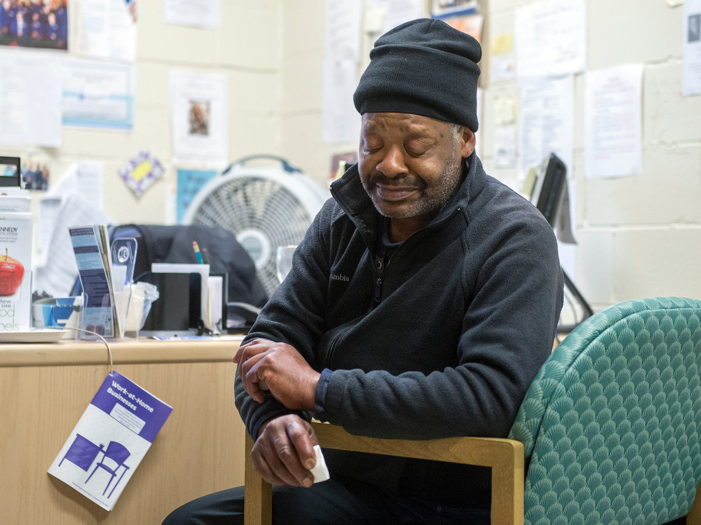 Robert Carroway, 60, who is homeless, becomes emotional as he reflects on his past circumstances Tuesday, Nov. 13, 2018 at Joseph's House in Camden, N.J. Carroway suffered multiple family tragedies over the years but is now on track to receive proper identification and social security.