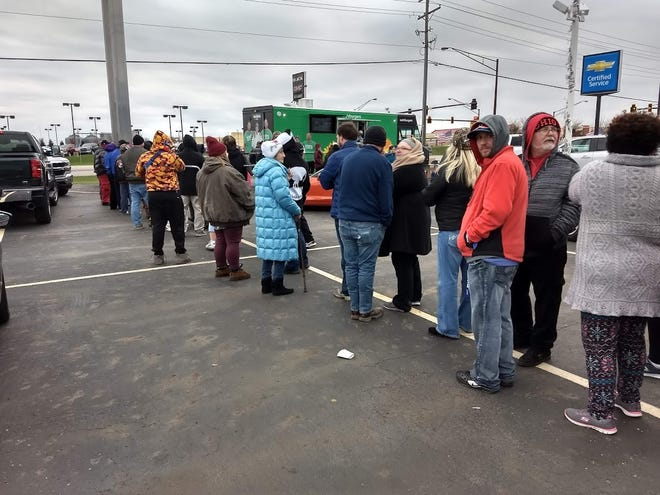 The line for free Wahlburgers at Mark Wahlberg Chevrolet was about three hours long