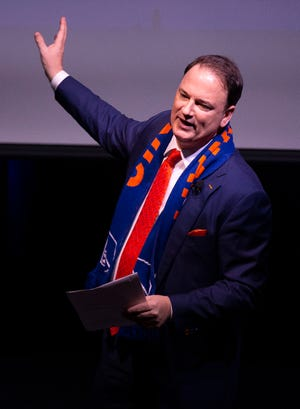General manager Jeff Berding prepares to unveil the new design during an event to unveil FC Cincinnati's new MLS branding at the Woodward Theater in the Over-the-Rhine neighborhood of Cincinnati on Monday, Nov. 12, 2018.