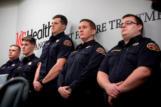 Colerain firefighter paramedics listen to Dr. Jason Schrager, Todd Allen and Dr. Kyle Walsh discuss the health of Andrew Allen, during a press conference at the Hoxworth Blood Center Tuesday, November 13, 2018. Andrew was hit by multiple cars as he crossed Springdale Road about a half mile from his home. The doctors and family of Andrew credit the firefighter paramedics with saving Andrew's life.