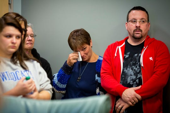 Shilo Allen (center) listens to her husband Todd Allen talk about the health of their son, Andrew, who was hit by multiple cars as he crossed Springdale Road, during a press conference at the Hoxworth Blood Center Tuesday, November 13, 2018. Their son and Andrew's brother, Brody, 2, died four weeks ago after a summer-long battle with a rare and aggressive brain cancer.