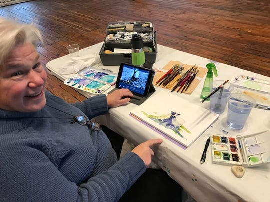 Former Mariemont resident Nancy Archdeacon of Morrow works on a painting in The Loft of the Woman's Art Club Cultural Center, also known as The Barn, Nov. 13, 2018.