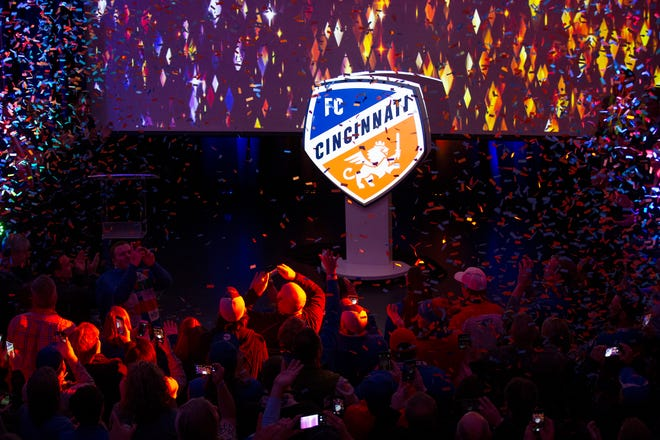 Confetti flies as the new team crest is unveiled during an event to unveil FC Cincinnati's new MLS branding at the Woodward Theater in the Over-the-Rhine neighborhood of Cincinnati on Monday, Nov. 12, 2018.