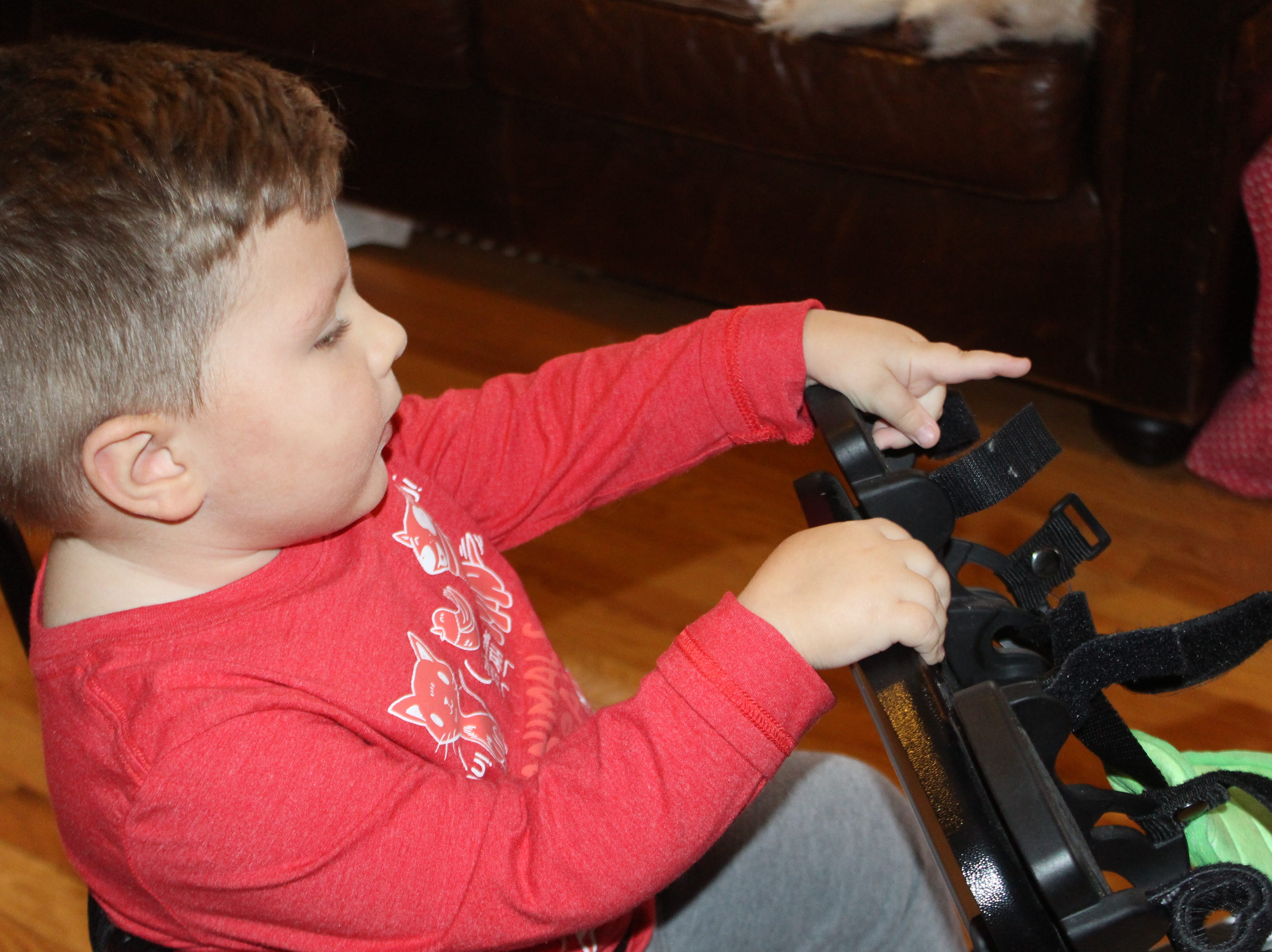 Oliver Schaper, who is receiving a first-of-its-kind treatment for spinal muscular atrophy, shows off a device that allows him to stand upright.
