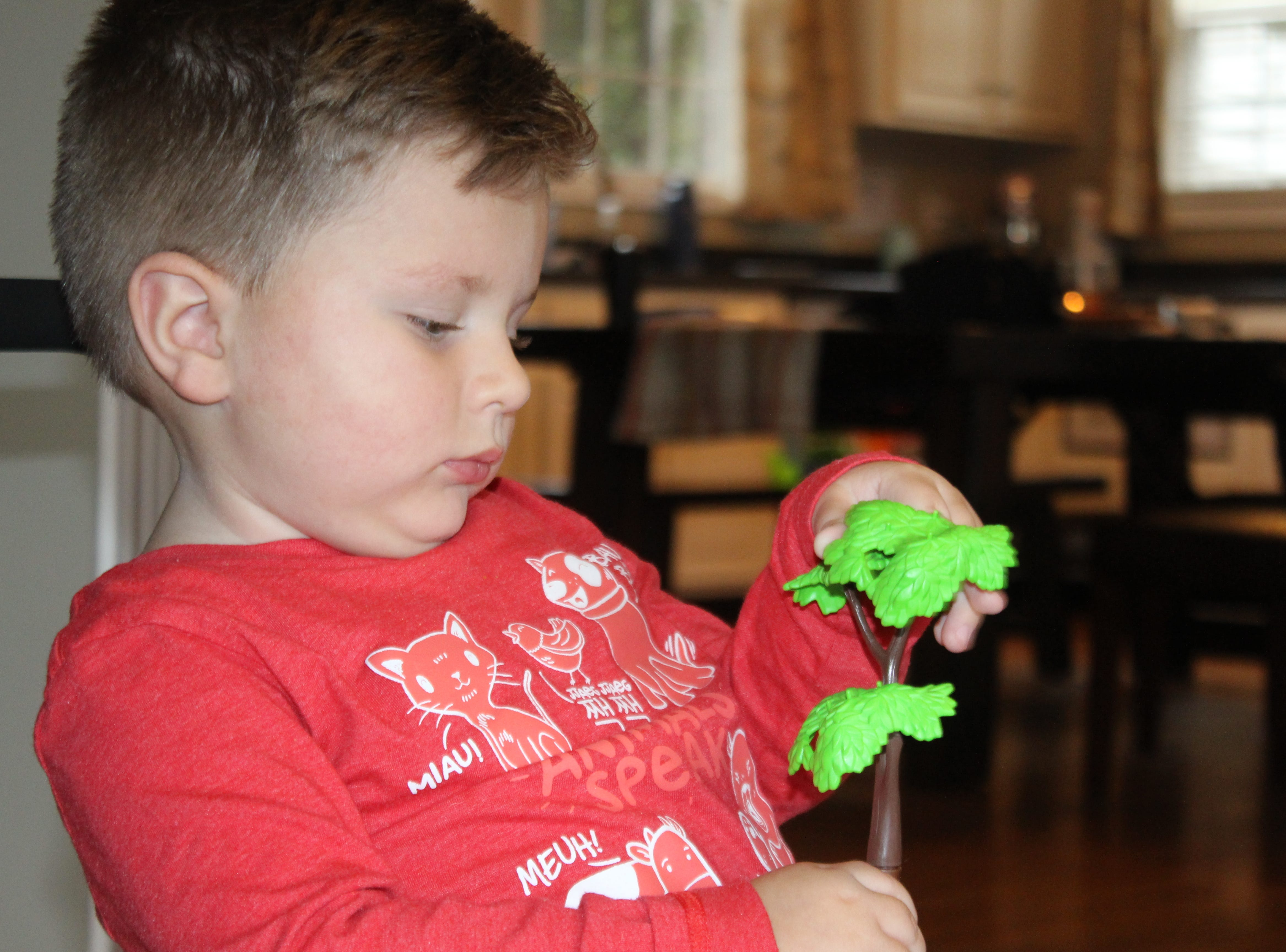 Oliver Schaper, who is receiving a first-of-its-kind treatment for spinal muscular atrophy, plays with a toy ... a simple act he would not have been able to do before his treatment.
