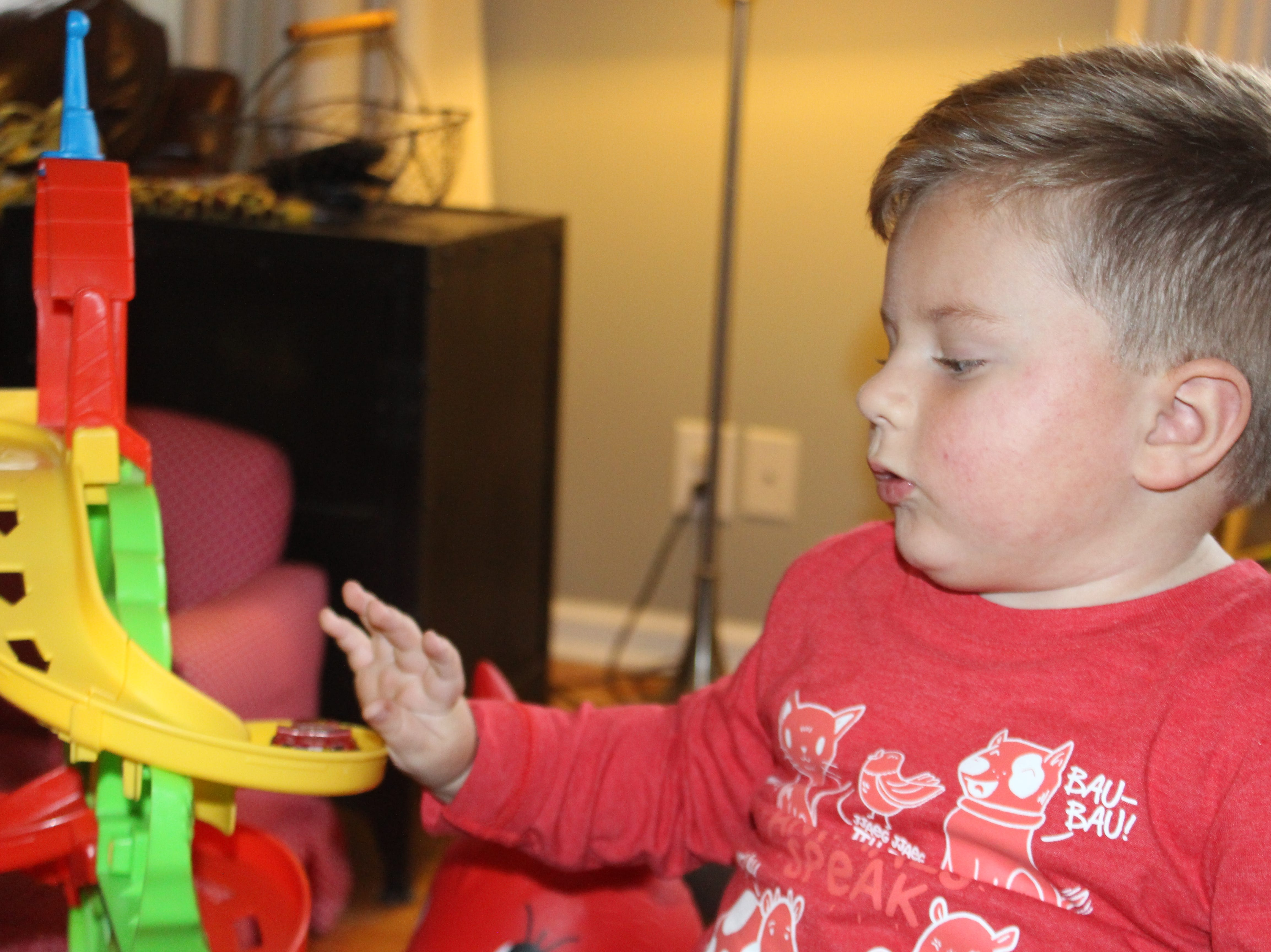 Oliver Schaper, who is receiving a first-of-its-kind treatment for spinal muscular atrophy, can now play with his toys thanks to the potentially lifesaving treatment.