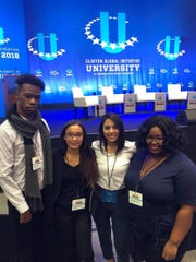 Kean students (l-r) Darnell Felder and Fernanda Moura; alumnus Gabriela Hurtada; and student Khamaya McClain attended the Clinton Global Initiative - University conference in Chicago, as members of Be the Change N.J.