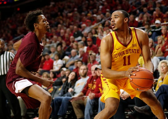 Iowa State guard Talen Horton-Tucker (11) drives past Texas Southern guard Derrick Bruce during the first half of an NCAA college basketball game, Monday, Nov. 12, 2018, in Ames, Iowa.