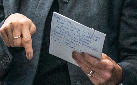 A close-up of Kim Reynolds' notes before her speech. Iowa Governor Kim Reynolds looks over her notes with members of her staff before speaking during an event celebrating national registered apprenticeship week on Tuesday, Nov. 13, 2018, at the Ottumwa Job Corps Center.