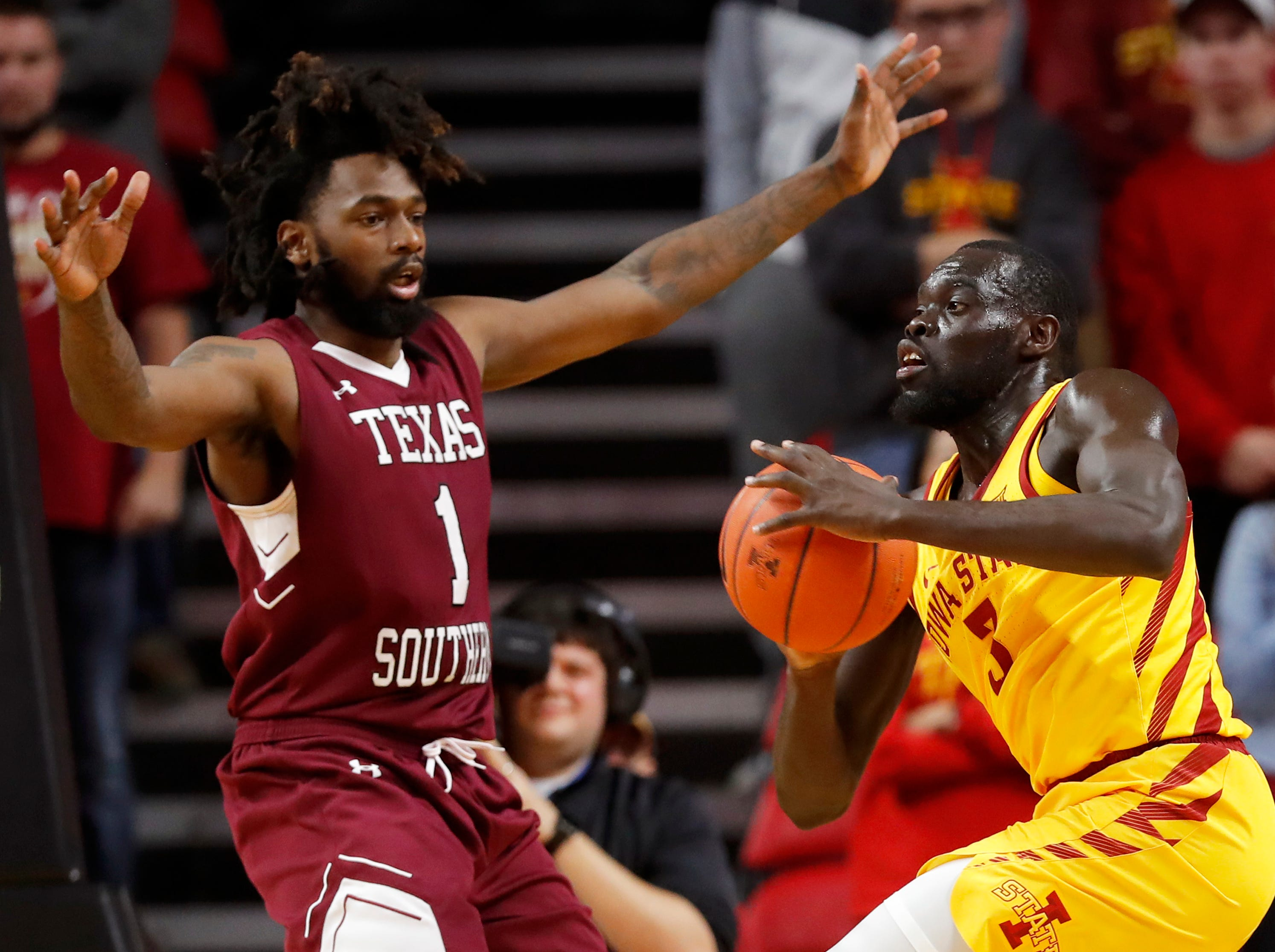 Iowa State guard Marial Shayok looks to pass in front of Texas Southern forward Jeremy Combs (1) during the second half of an NCAA college basketball game, Monday, Nov. 12, 2018, in Ames, Iowa. Iowa State won 85-73.