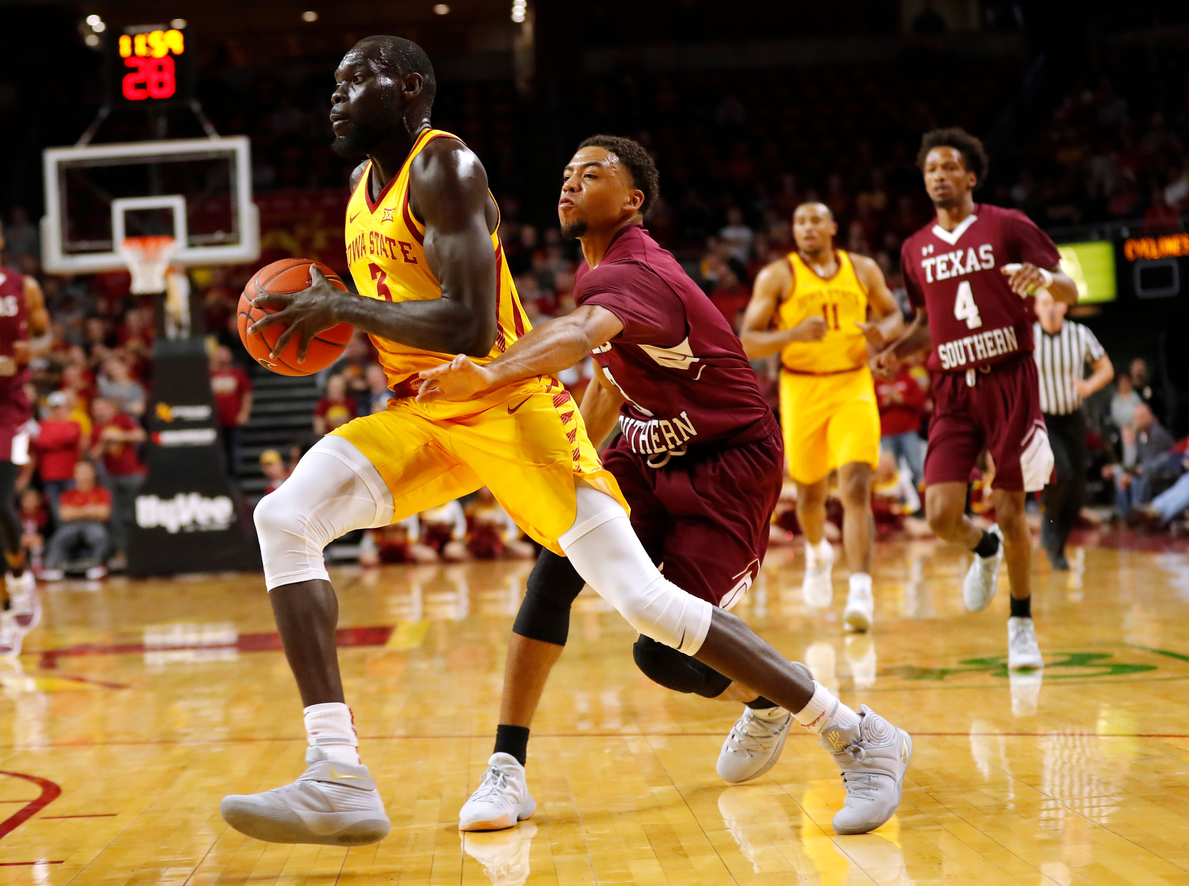 Iowa State guard Marial Shayok, left, drives to the basket past Texas Southern guard Jalyn Patterson during the first half of an NCAA college basketball game, Monday, Nov. 12, 2018, in Ames, Iowa.