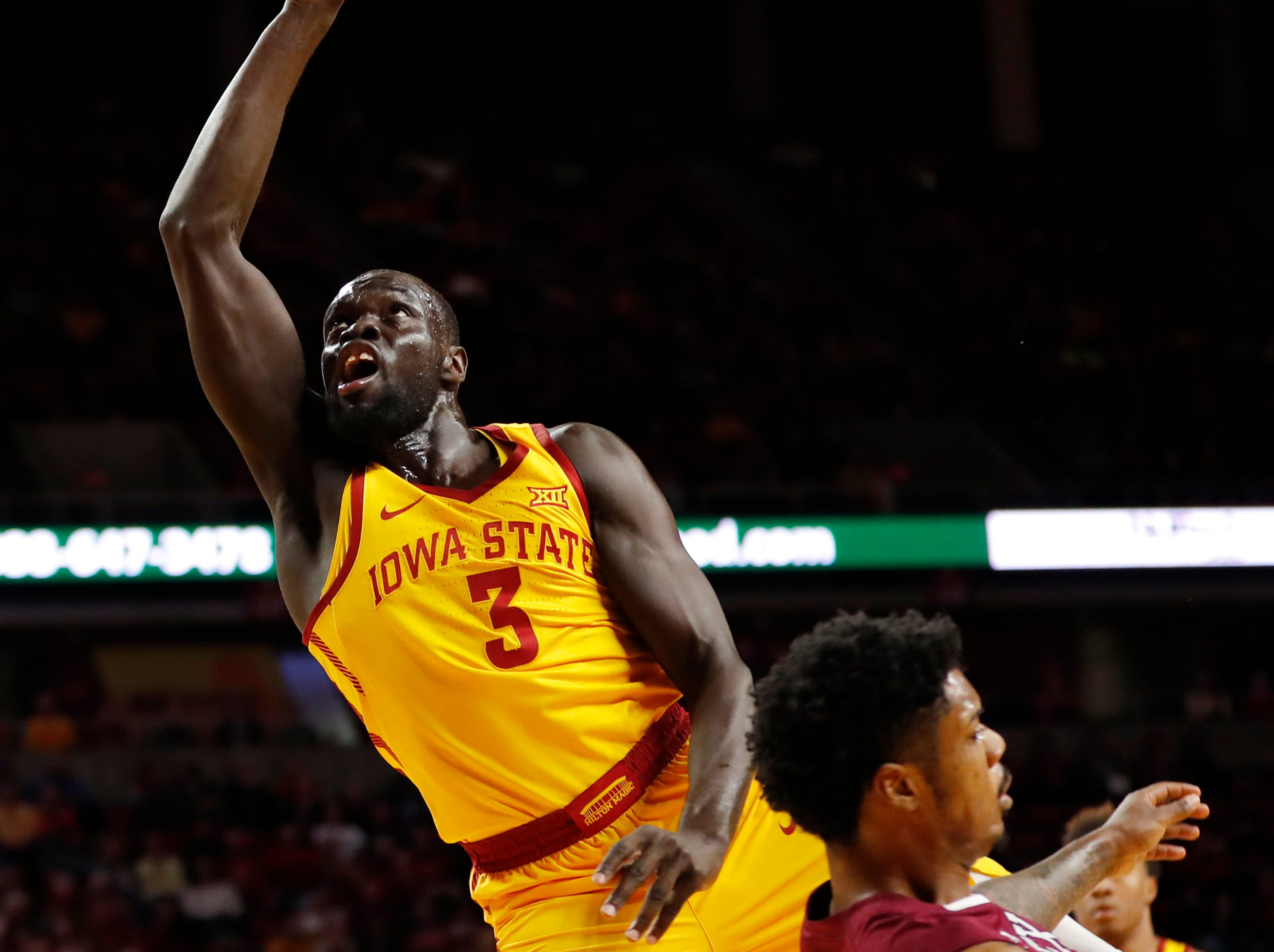 Iowa State guard Marial Shayok (3) is fouled by Texas Southern forward Devocio Butler, right, while driving to the basket during the first half of an NCAA college basketball game, Monday, Nov. 12, 2018, in Ames, Iowa.