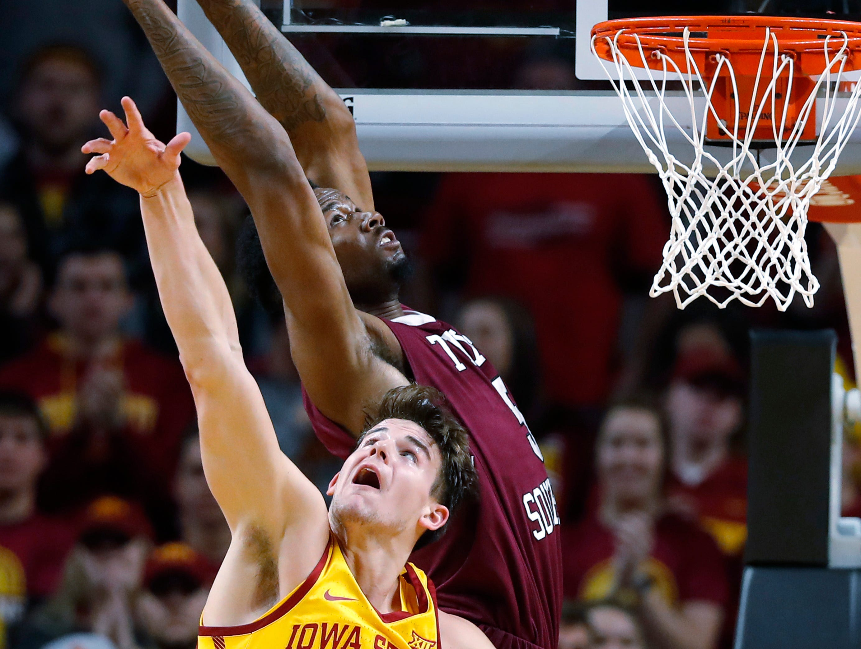 Texas Southern center Trayvon Reed grabs a rebound over Iowa State forward Michael Jacobson (12) during the first half of an NCAA college basketball game, Monday, Nov. 12, 2018, in Ames, Iowa.