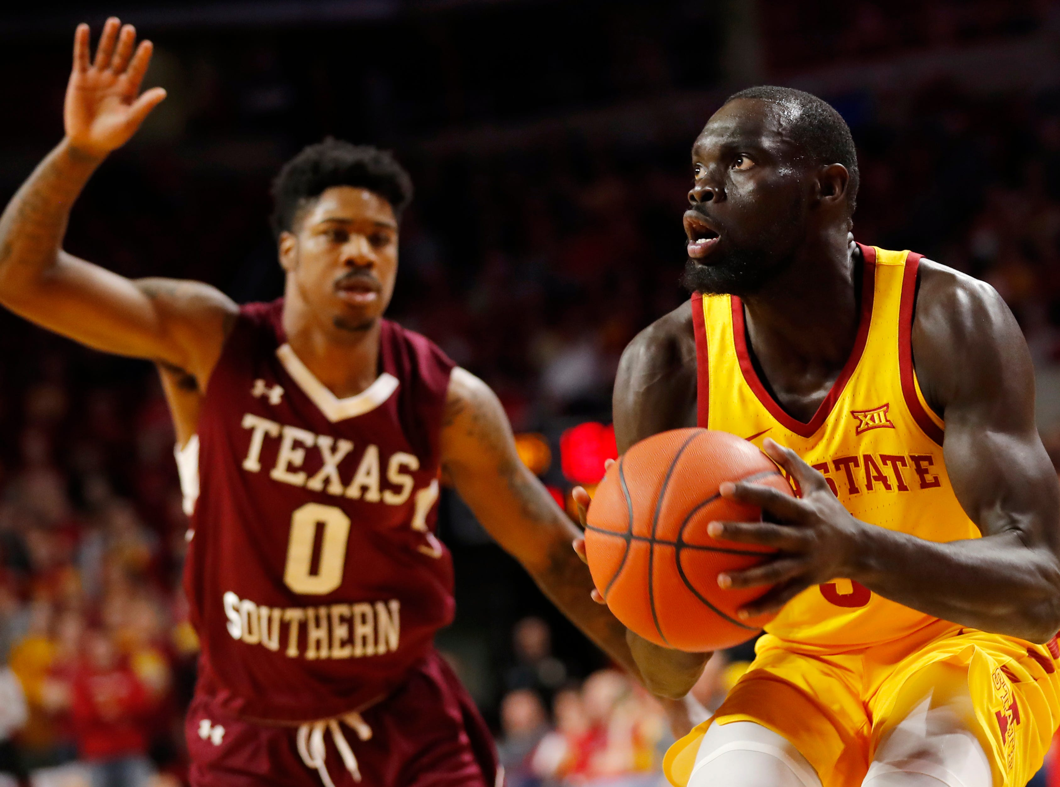 Iowa State guard Marial Shayok drives to the basket past Texas Southern forward Devocio Butler (0) during the first half of an NCAA college basketball game, Monday, Nov. 12, 2018, in Ames, Iowa.