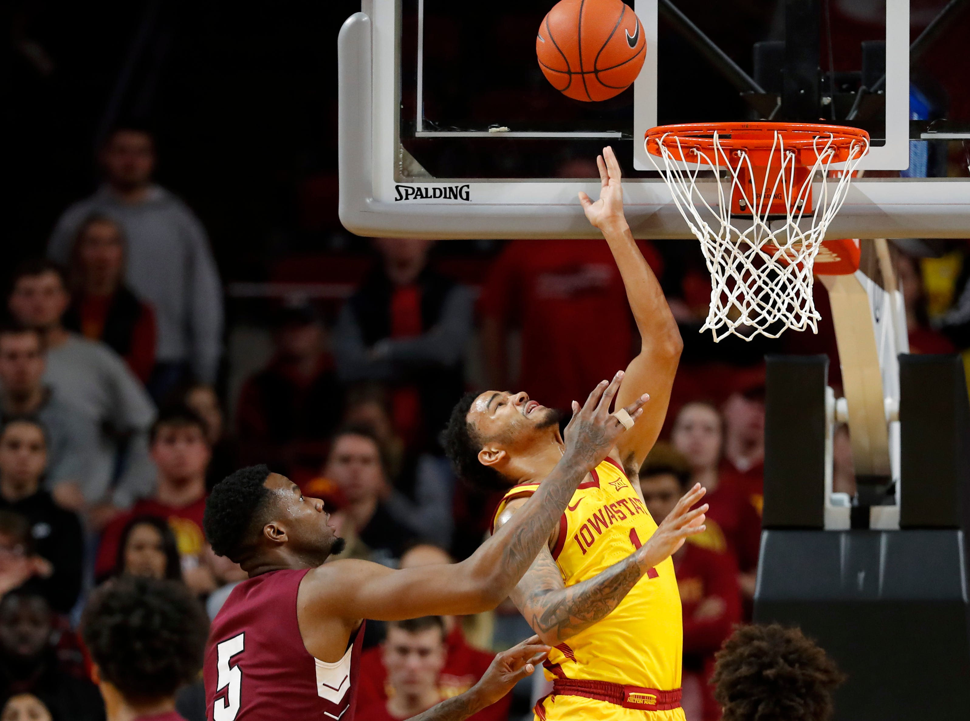 Iowa State guard Nick Weiler-Babb (1) is fouled by Texas Southern center Trayvon Reed (5) during the second half of an NCAA college basketball game, Monday, Nov. 12, 2018, in Ames, Iowa.