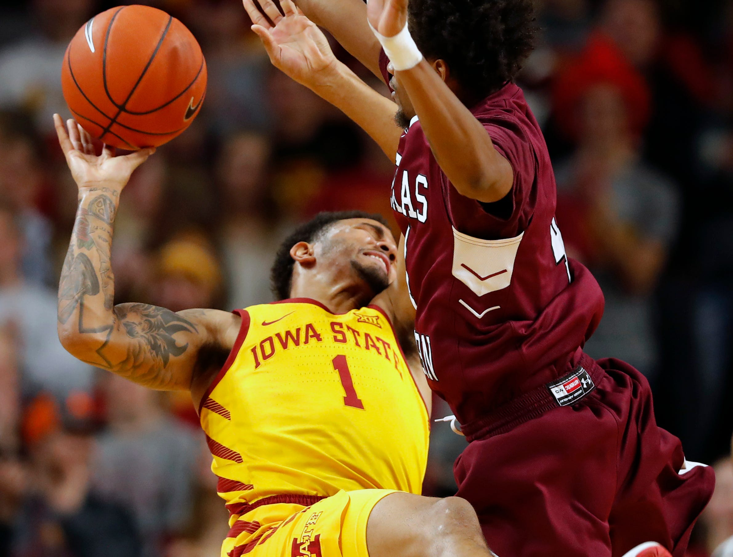 Iowa State guard Nick Weiler-Babb (1) is fouled by Texas Southern guard Derrick Bruce, right, during the first half of an NCAA college basketball game, Monday, Nov. 12, 2018, in Ames, Iowa.