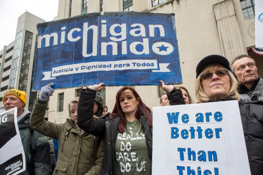 From left, Raskelle Ocenasek, 20 of Warren, Bridget Huff, 38 of St. Clair and Jane Benkarsk, 61 of Brighton stand in support of Ded Rranxburgaj with other supporters outside the Theodore Levin U.S. Courthouse in Detroit, Mich., Monday, Nov. 12, 2018. Ded has been in sanctuary at the Central United Methodist Church in Detroit for months.