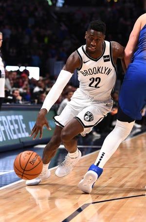Brooklyn Nets guard Caris LeVert dribbles against the Denver Nuggets on Nov. 9, 2018 in Denver.