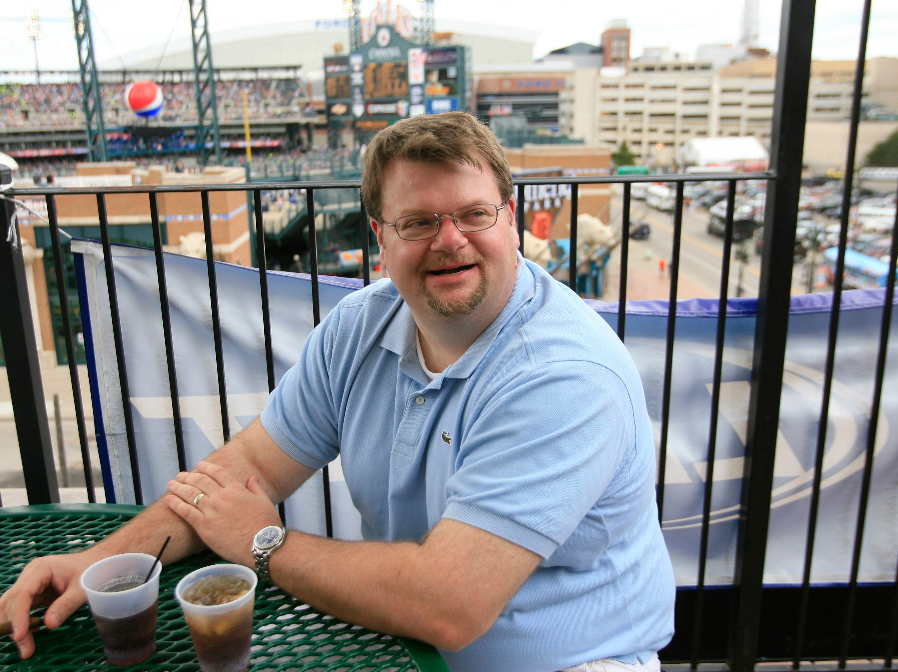 Tony Dahm, 38, of Madison Heights finds a hiding spot to smoke his cigar on the roof of Cheli's Chili Bar in Detroit in 2010.