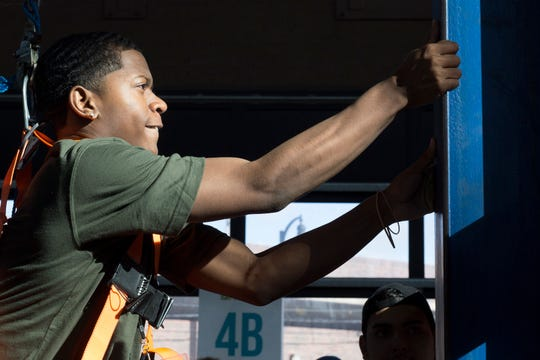 Romulus High School senior, Anthony Fortson, 17, grips a beam while climbing to reach the top during a demonstration with International Association of Ironworkers during the Sachse Construction Academy in partnership with Junior Achievement, on Tuesday, Oct. 23, 2018 at Eastern Market in Detroit. Over 500 Detroit high school students arrived at Eastern Market to learn about different companies and over 40 different skilled trades.