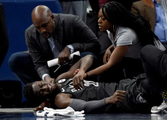 Caris LeVert is tended to after the injury during the second quarter Monday.