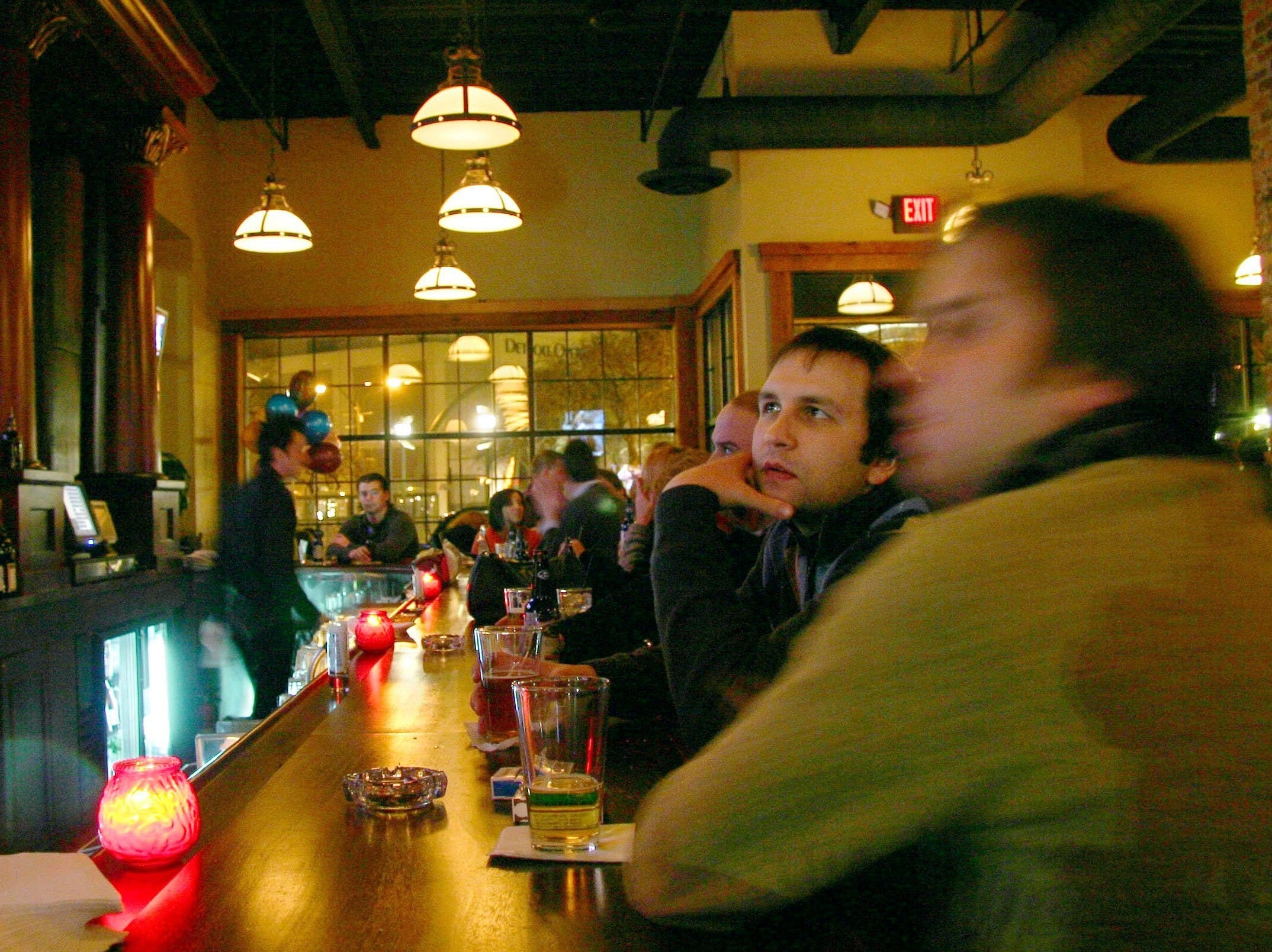 Eric Seitz, 25, of Bloomfield Hills, Vic Chelovich, 26, of Bloomfield Hills and Maggie McCafferty, 25, of Royal Oak came to Cheli's Chili Bar in Detroit for celebrate a friend's birthday and watch some television on February 18, 2006.
