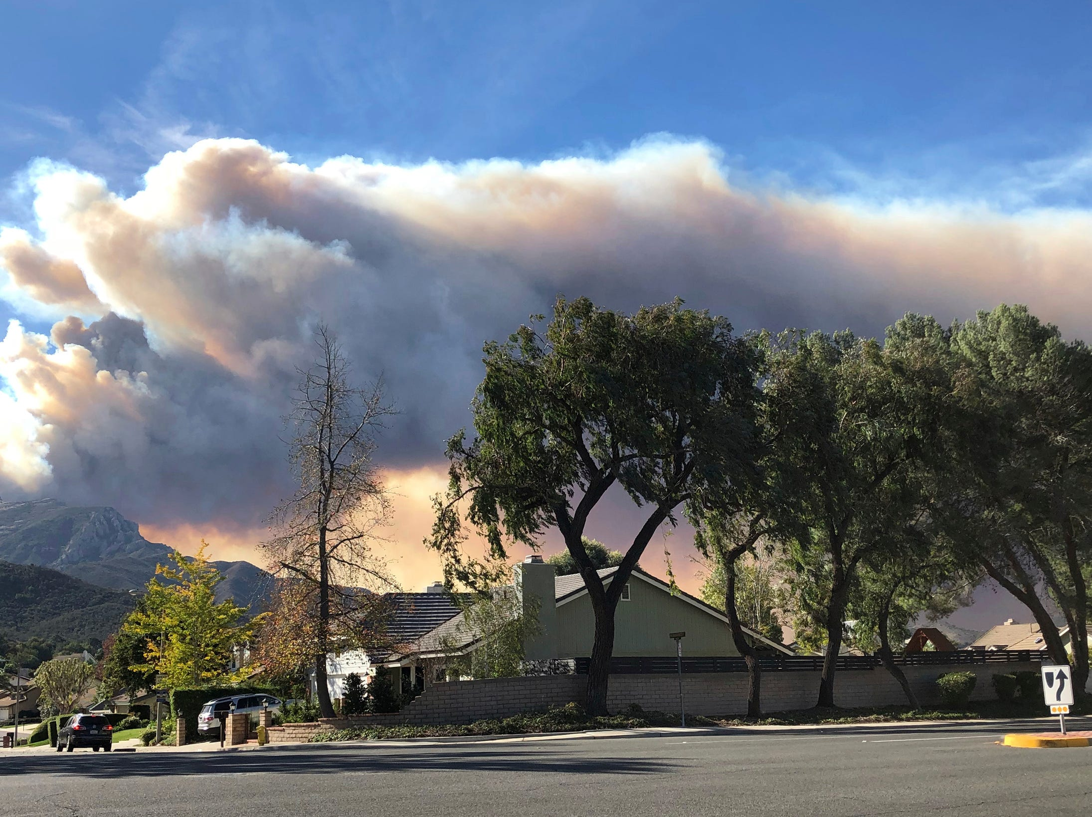 A large wildfire plume from a recent flareup near Lake Sherwood, Calif., is visible from Thousand Oaks, Calif., Tuesday, Nov. 13, 2018.
