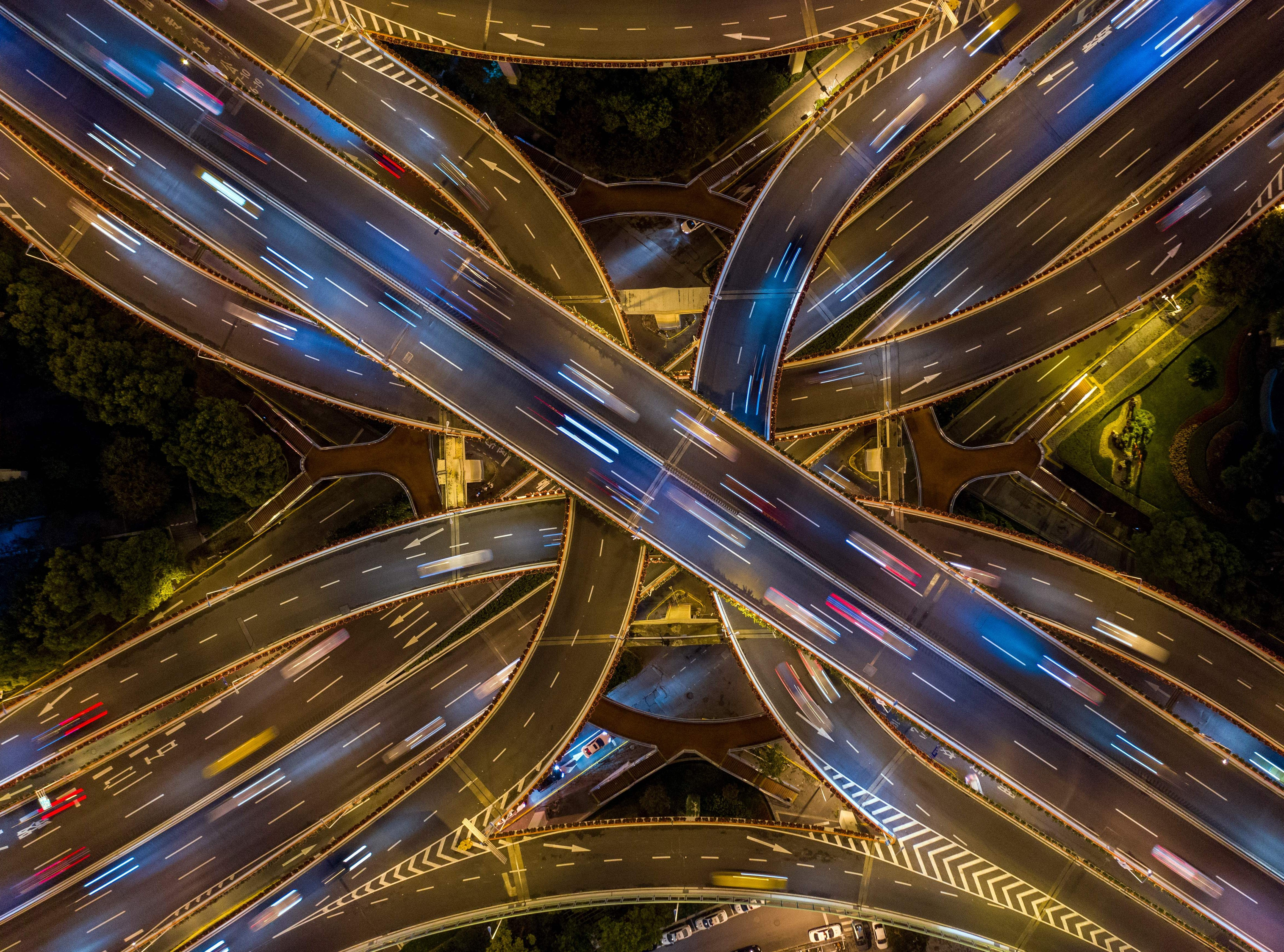 This aerial picture taken on the night of November 12, 2018 shows traffic on an elevated intersection in downtown Shanghai.