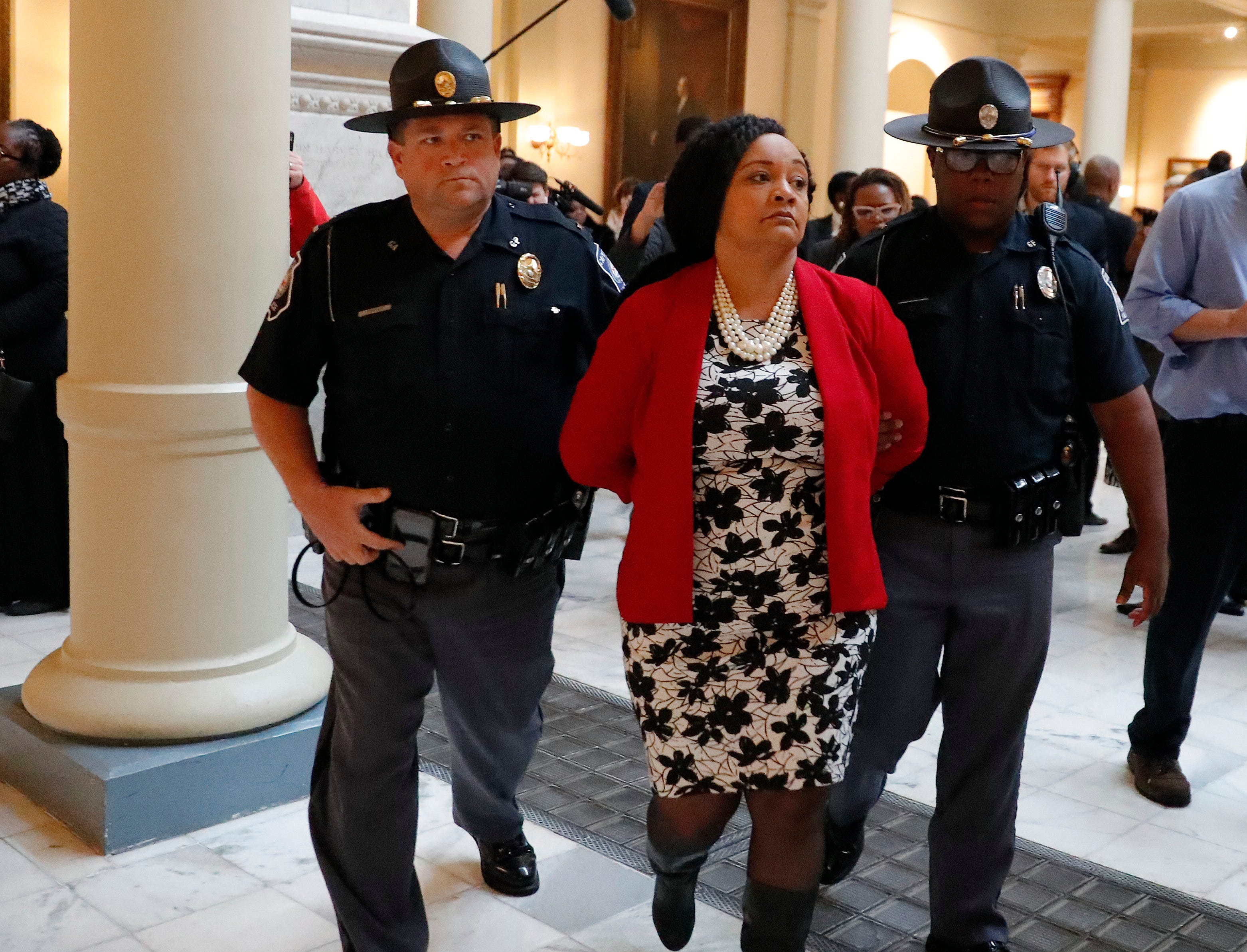 Sen. Nikema Williams, D-Atlanta, is arrested by capitol police during a protest over election ballot counts in the rotunda of the state capitol building Tuesday, Nov. 13, 2018, in Atlanta.
