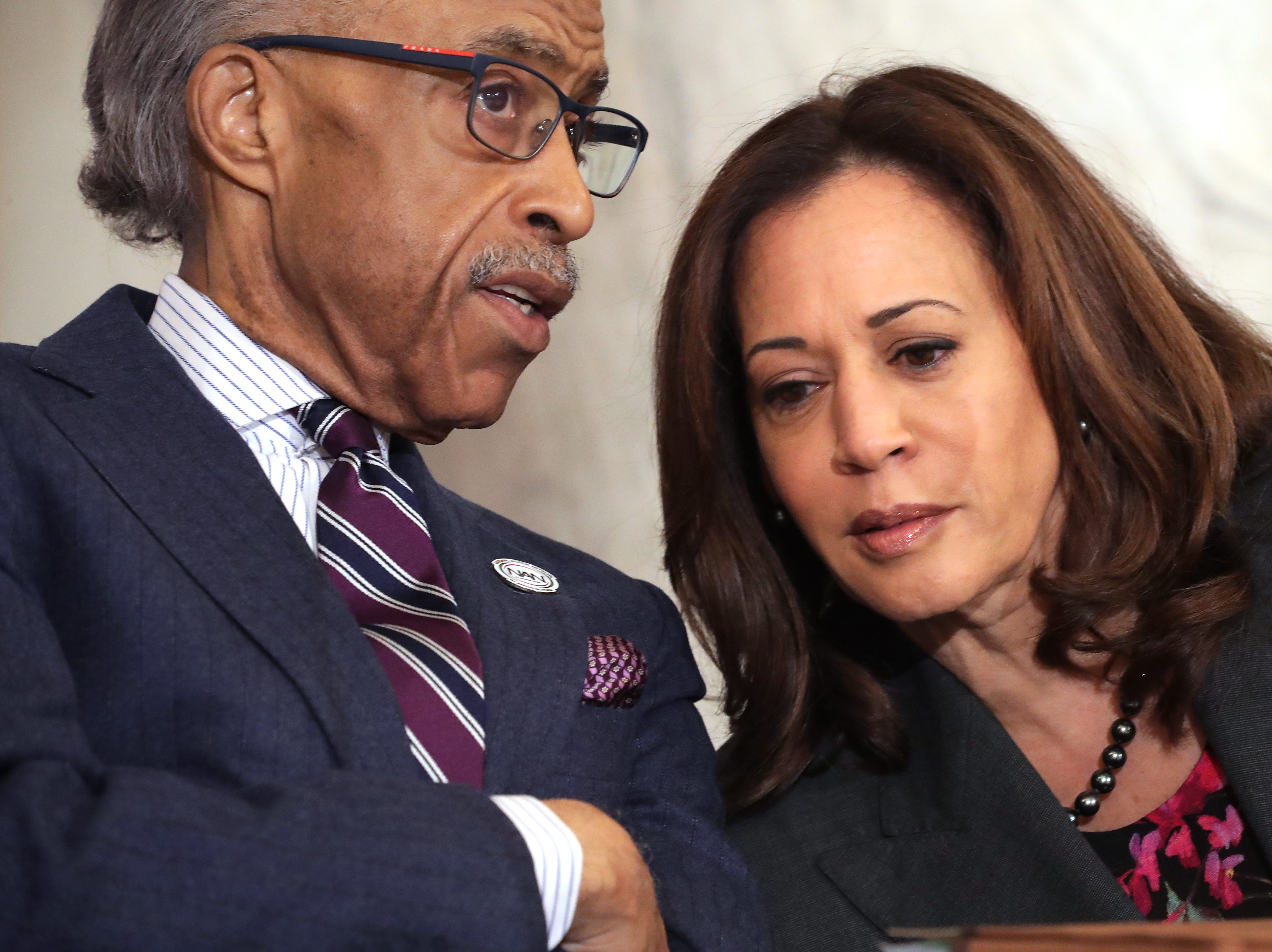 The Rev. Al Sharpton talks with Sen. Kamala Harris, D-Calif., during a post-midterm election meeting of Sharpton's National Action Network in the Kennedy Caucus Room at the Russell Senate Office Building on Capitol Hill, November 13, 2018, in Washington, D.C. Politicians believed to be considering a run for the 2020 Democratic party nomination, including Sen. Elizabeth Warren, D-Mass., and Harris addressed the network meeting as well as House members vying for leadership positions.