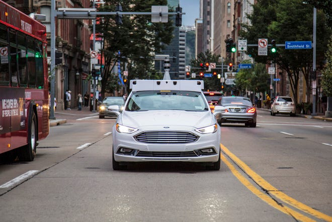 An Argo AI self-driving car. Volkswagen AG is negotiating to invest potentially more than $1 billion in Argo AI, the robotics and technology company majority-owned by Ford Motor Co., as part of partnership discussions between the two automakers.