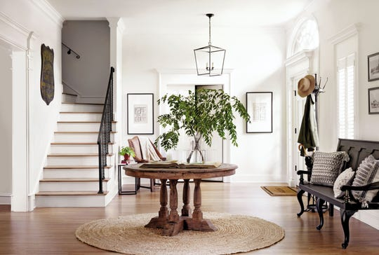 "The entrance to this estate features a table, which isn't typical for an entryway, writes Joanna Gaines, but ""it helps define the entry so it doesn't fade into the larger context of the room."""