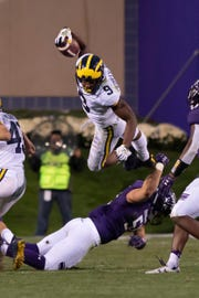 Michigan wide receiver Donovan Peoples-Jones flies over Northwestern linebacker Blake Gallagher while returning a punt against the Wildcats in the Wolverines' 20-17 victory Sept. 29.